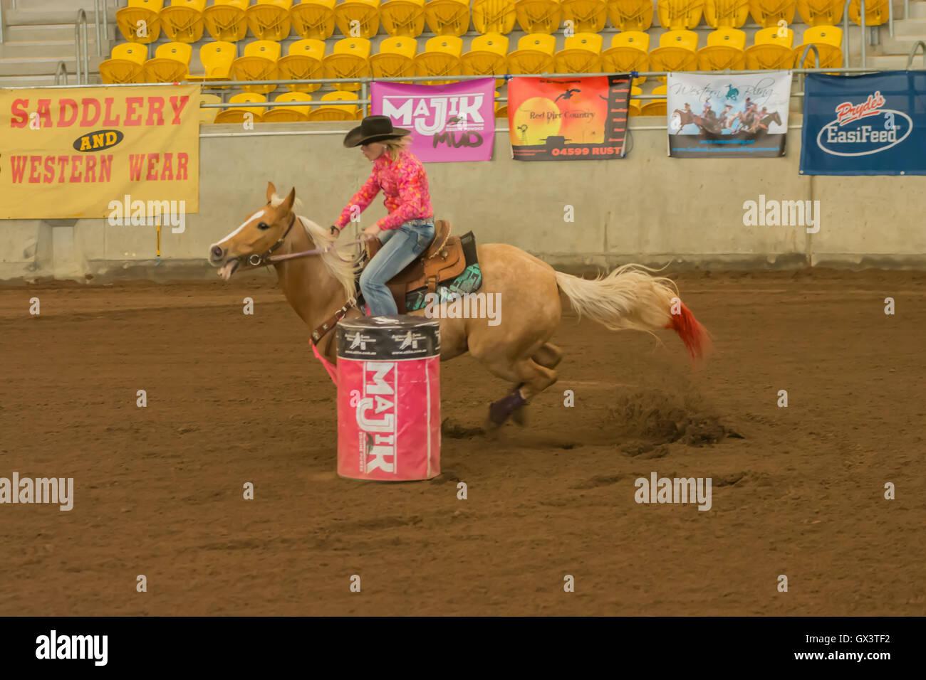 Cowgirl Barrel Racing At An Indoor Arena Tamworth Australia Stock Photo Alamy