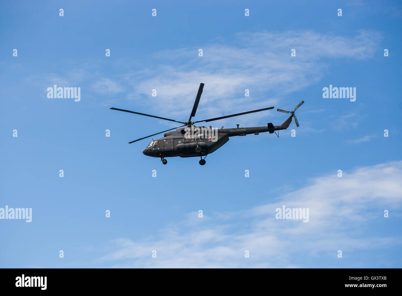 Russian military helicopter MI-8 in the blue sky - Stock Image