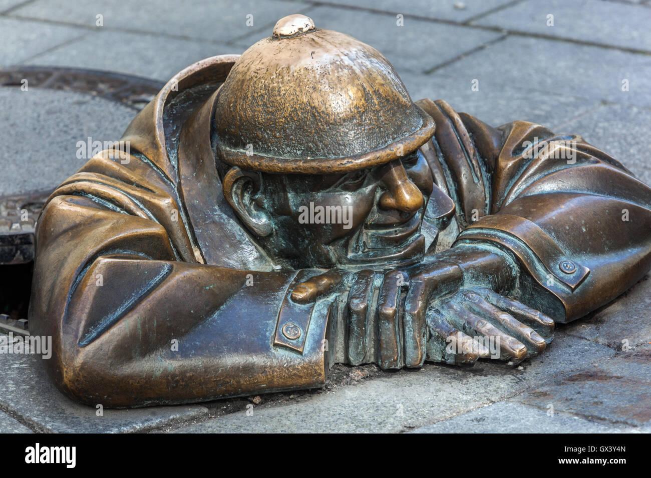 Canal worker statue by Viktor Hulik, Sculpture on the sidewalk, Art, Laurinska Street, Old Town street, Bratislava, - Stock Image