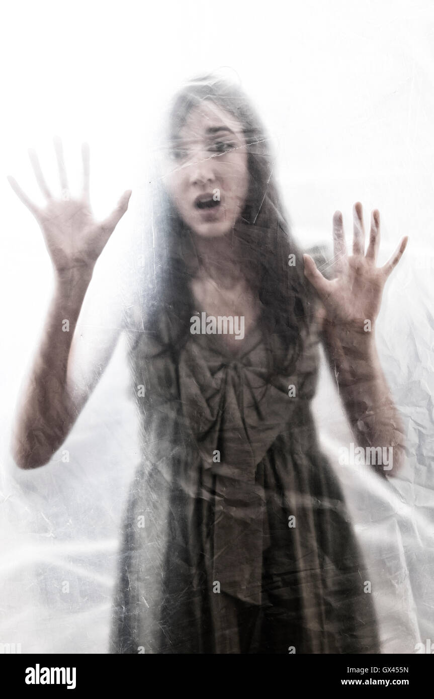 Scared woman trapped - Stock Image