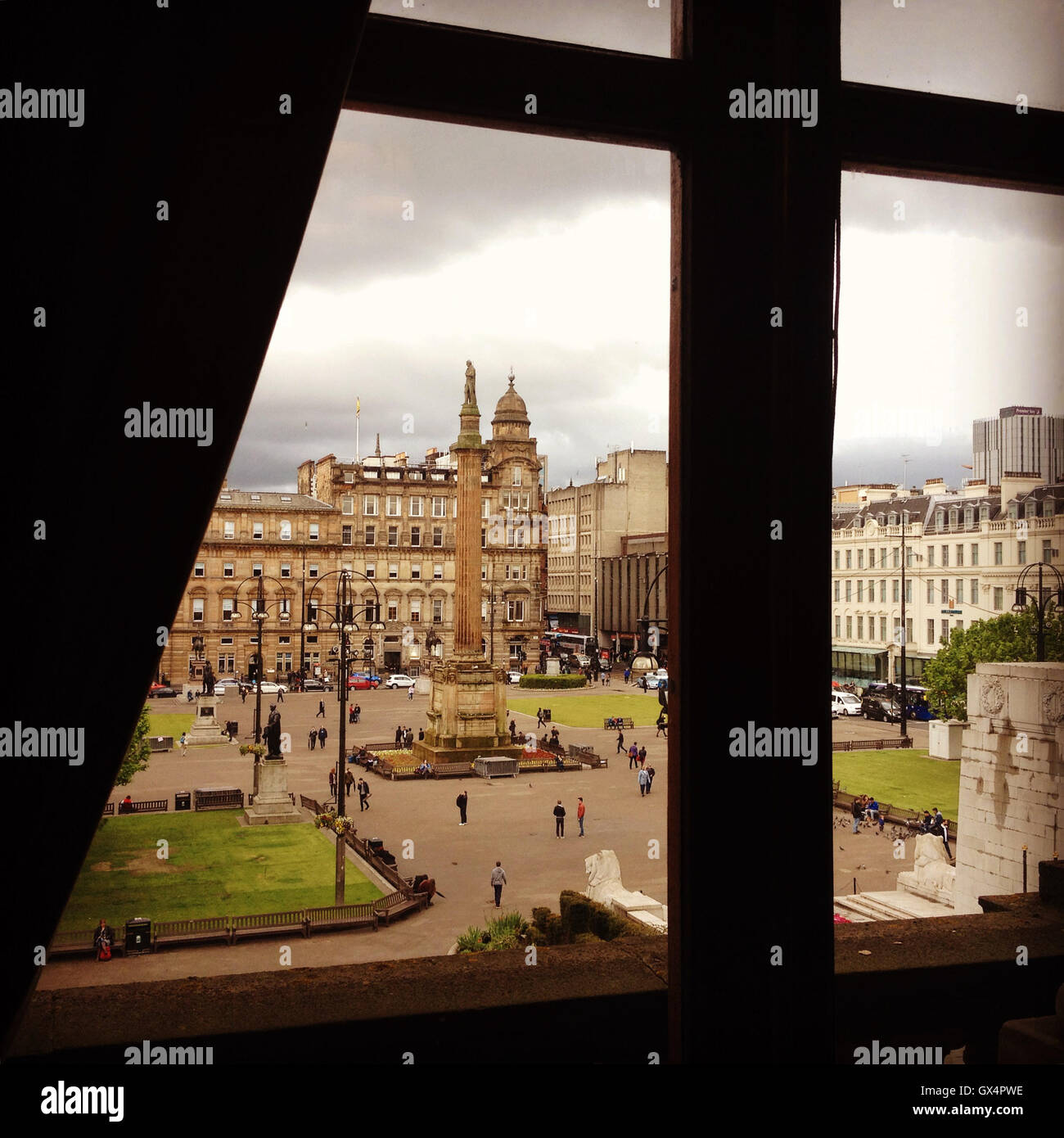 George Square viewed from within the City Chambers in Glasgow, Scotland. Column in middle hold statue of Sir Walter - Stock Image