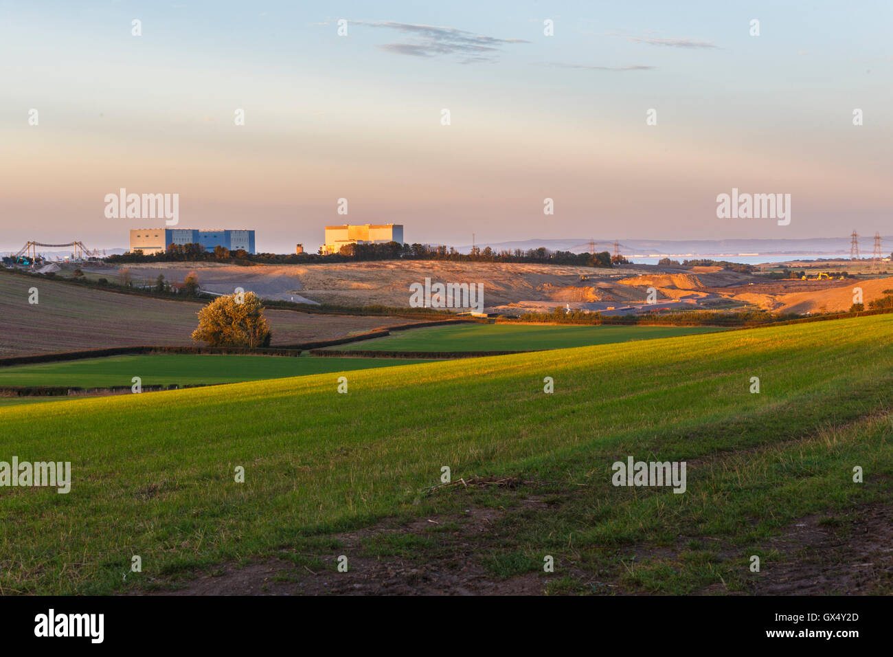 Hinkley point A station to left, B station to right. Groundworks for Hinkley point C in front of existing stations. - Stock Image