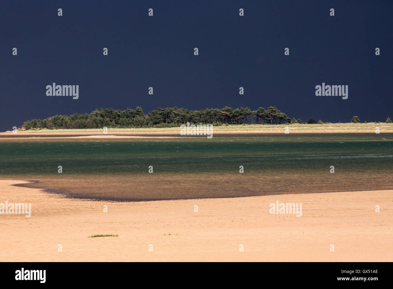 view of the beach at Wells-next-the-sea, Norfolk during a thunderstorm in summer - Stock Image