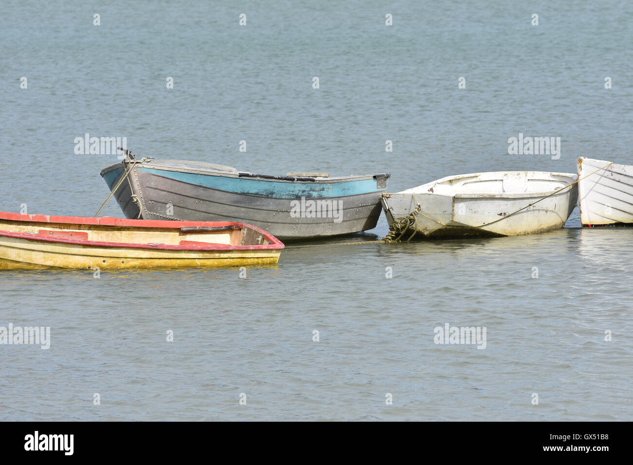 Small worn out dinghy boats - Stock Image