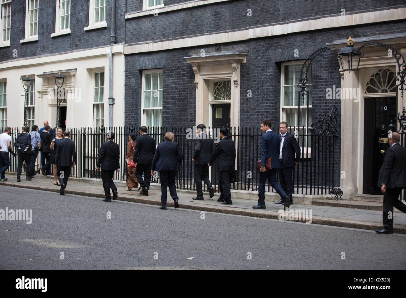 London, UK. The delegation from Myanmar accompanying Aung San Suu Kyi moves along Downing Street to No. 11 for discussions. - Stock Image