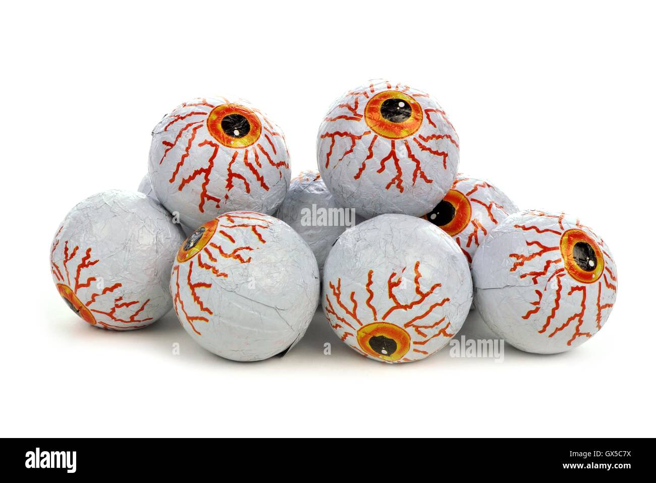 Pile of Halloween candy eyeballs over a white background - Stock Image