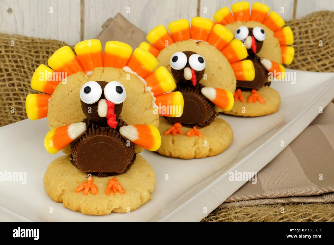 Homemade Thanksgiving turkey shaped cookies on a plate - Stock Image