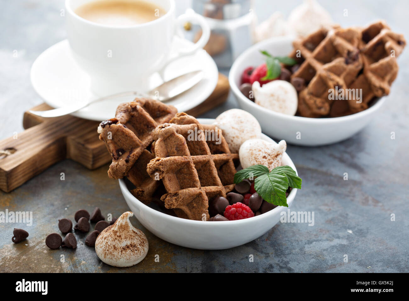 Chocolate waffles with meringues and coffee - Stock Image