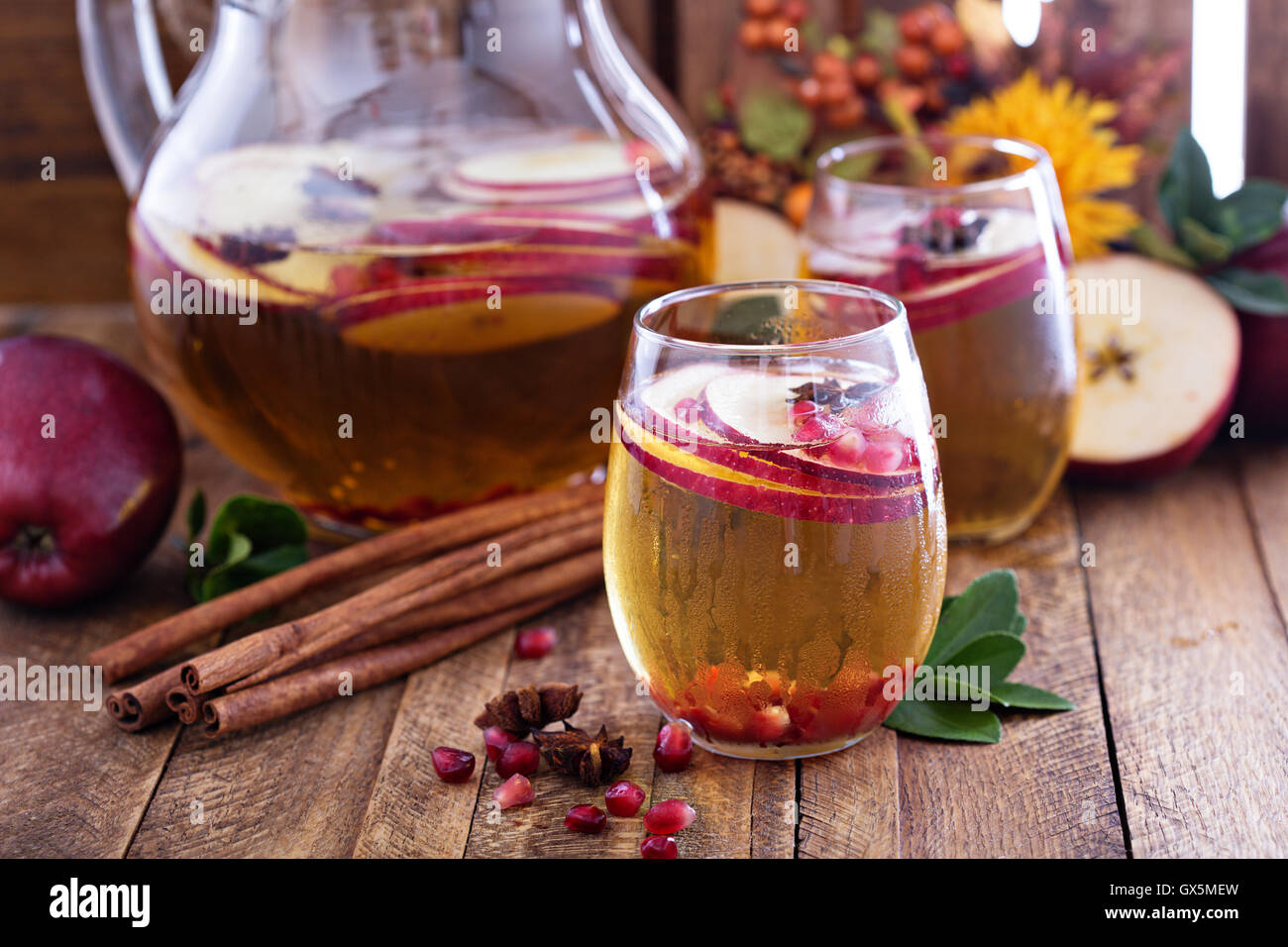 Fall sparkling drink with apple cider and pomegranate Stock Photo