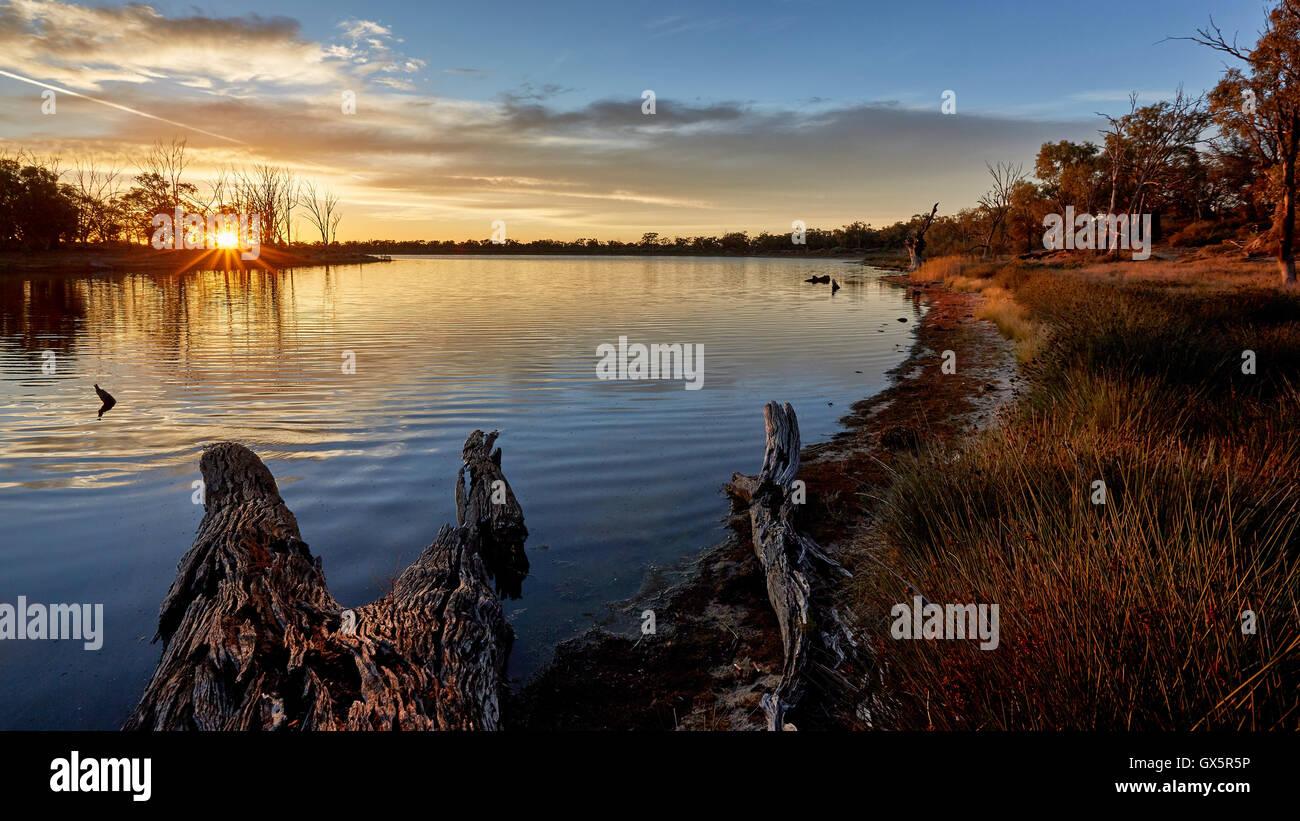 Sunrise over a quiet billabong near Mildura Australia - Stock Image