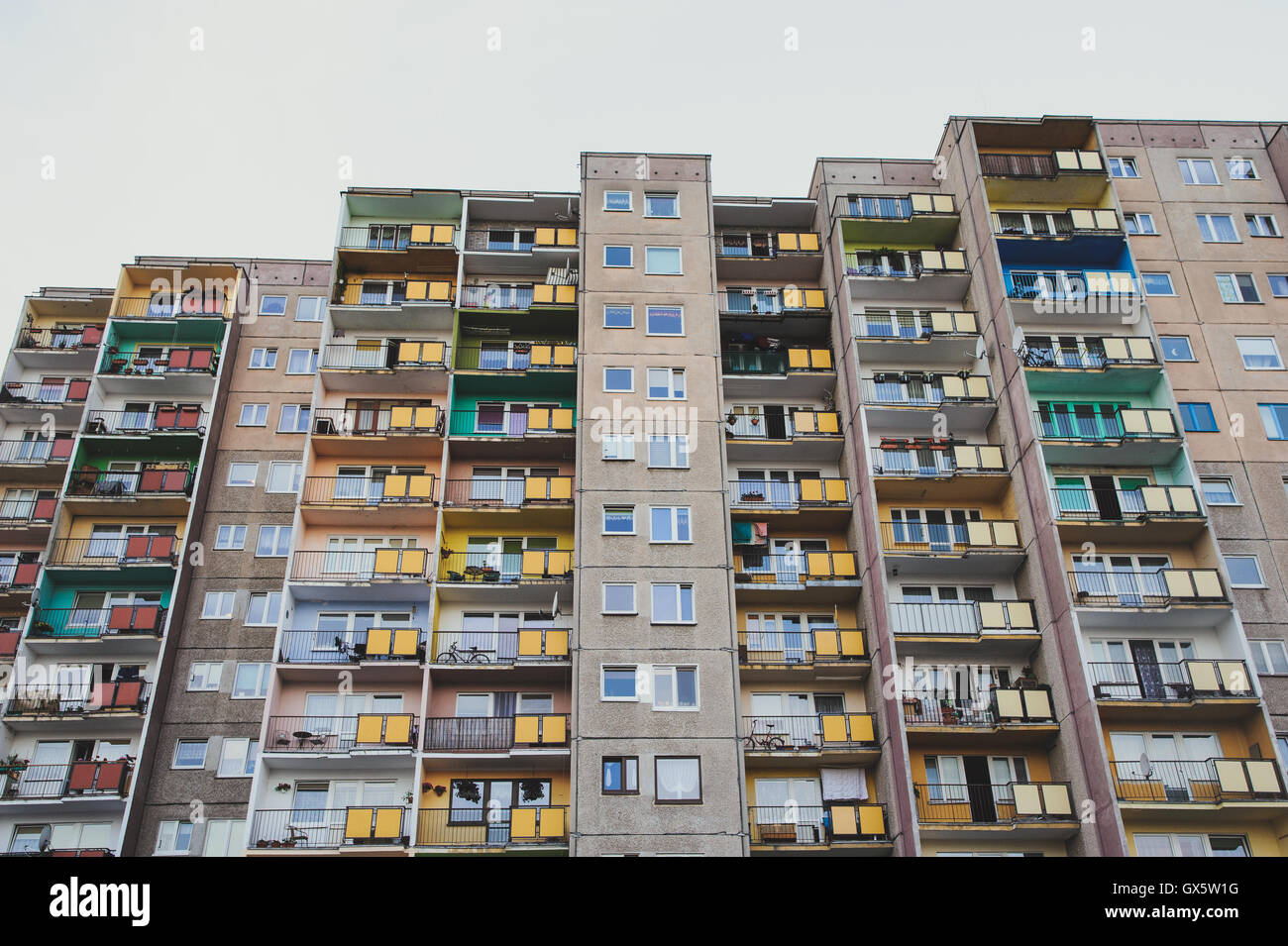 blocks of flats against blue cloudy sky - Stock Image