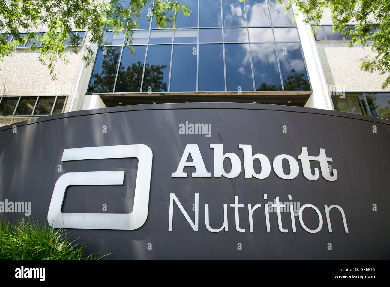 A logo sign outside of a facility occupied by Abbott