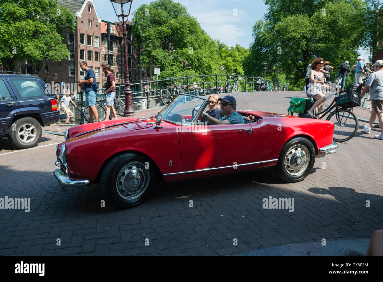 Bridge over the Prinsengracht at the edge of the Jordaan bordering the Brouwersgracht. A very busy crossing. - Stock Image