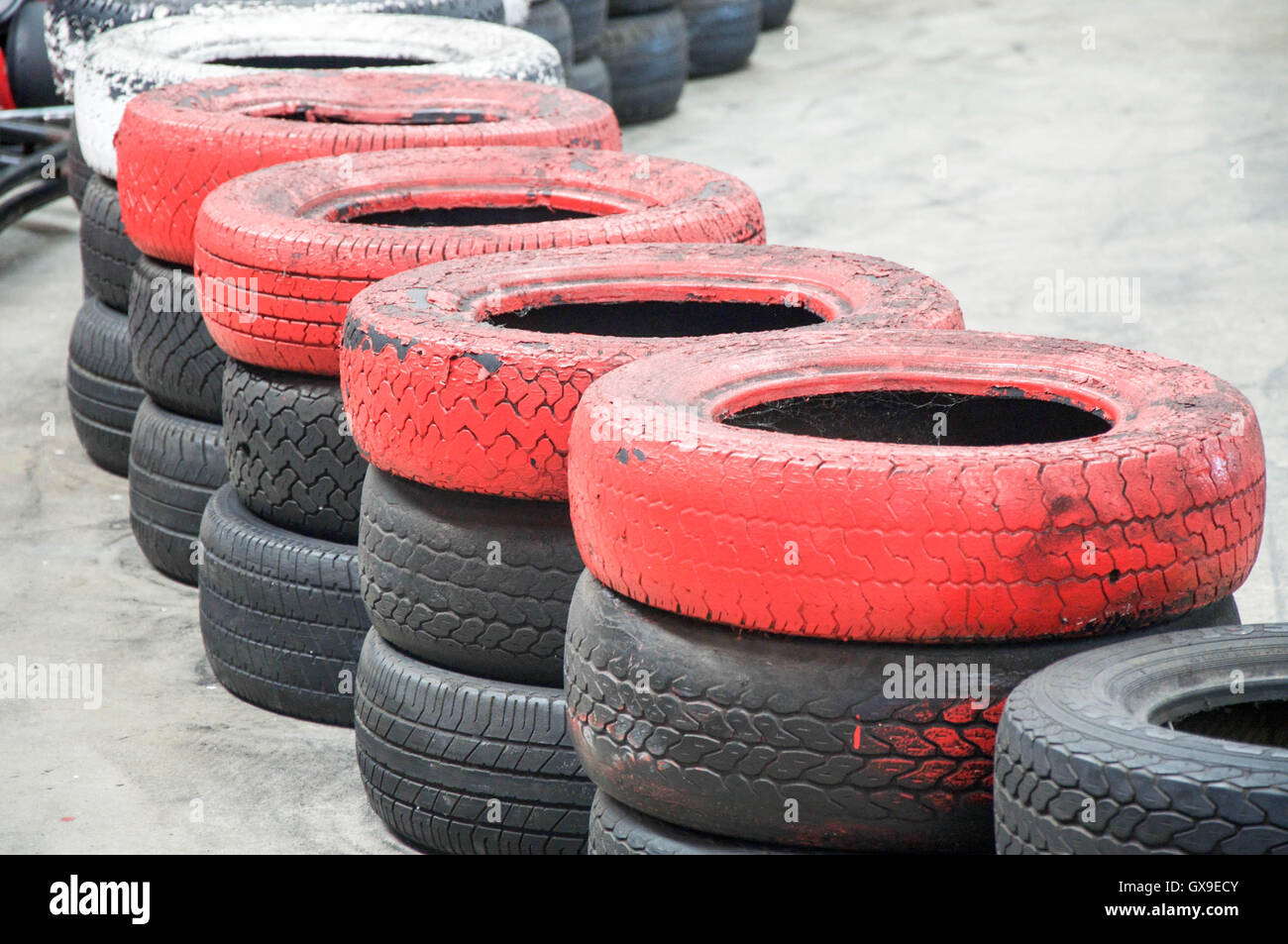 Abstract of stacked red, white and black tire boundary at go kart ...