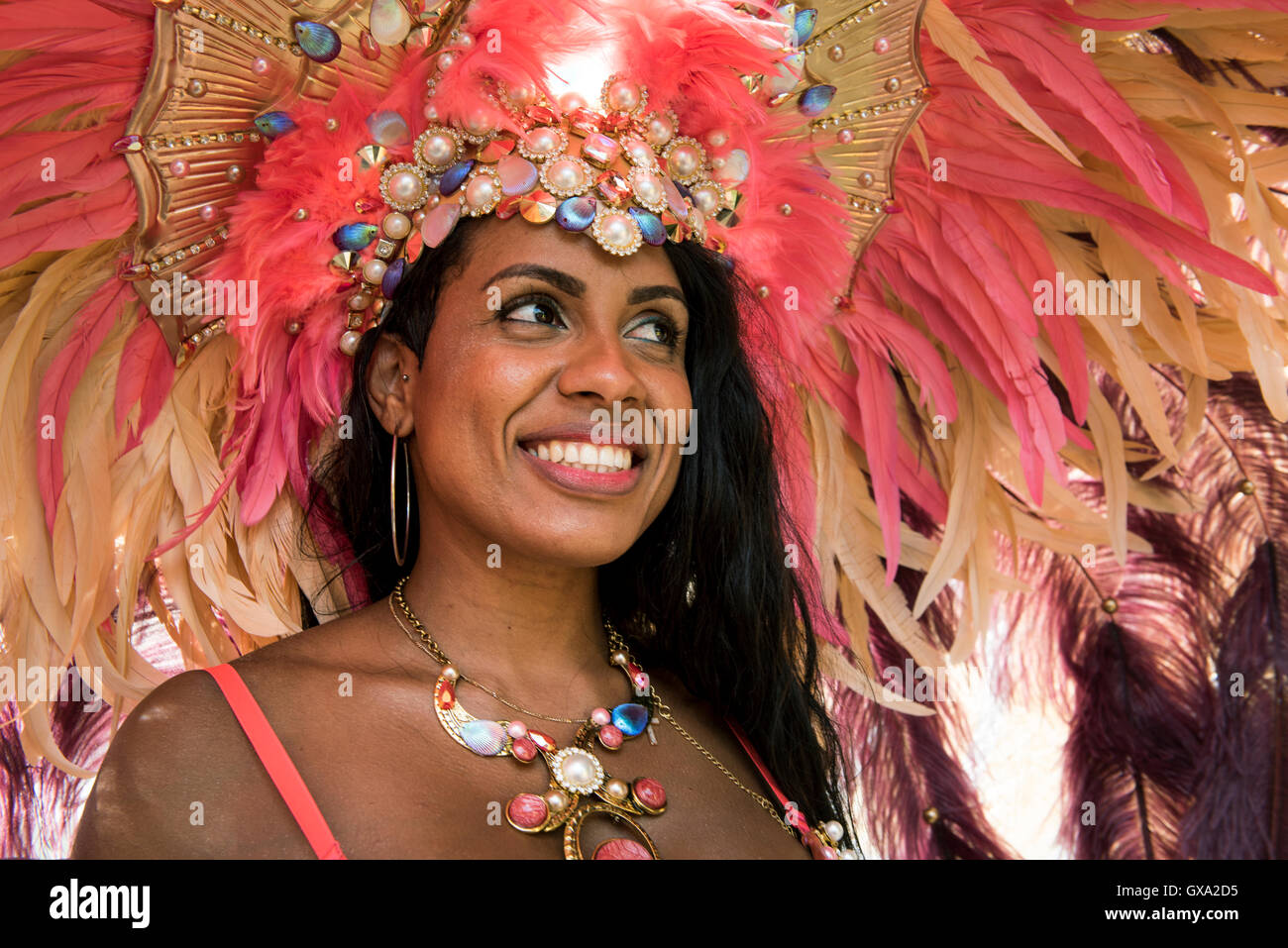 Smiling reveller at Notting Hill Carnival - Stock Image