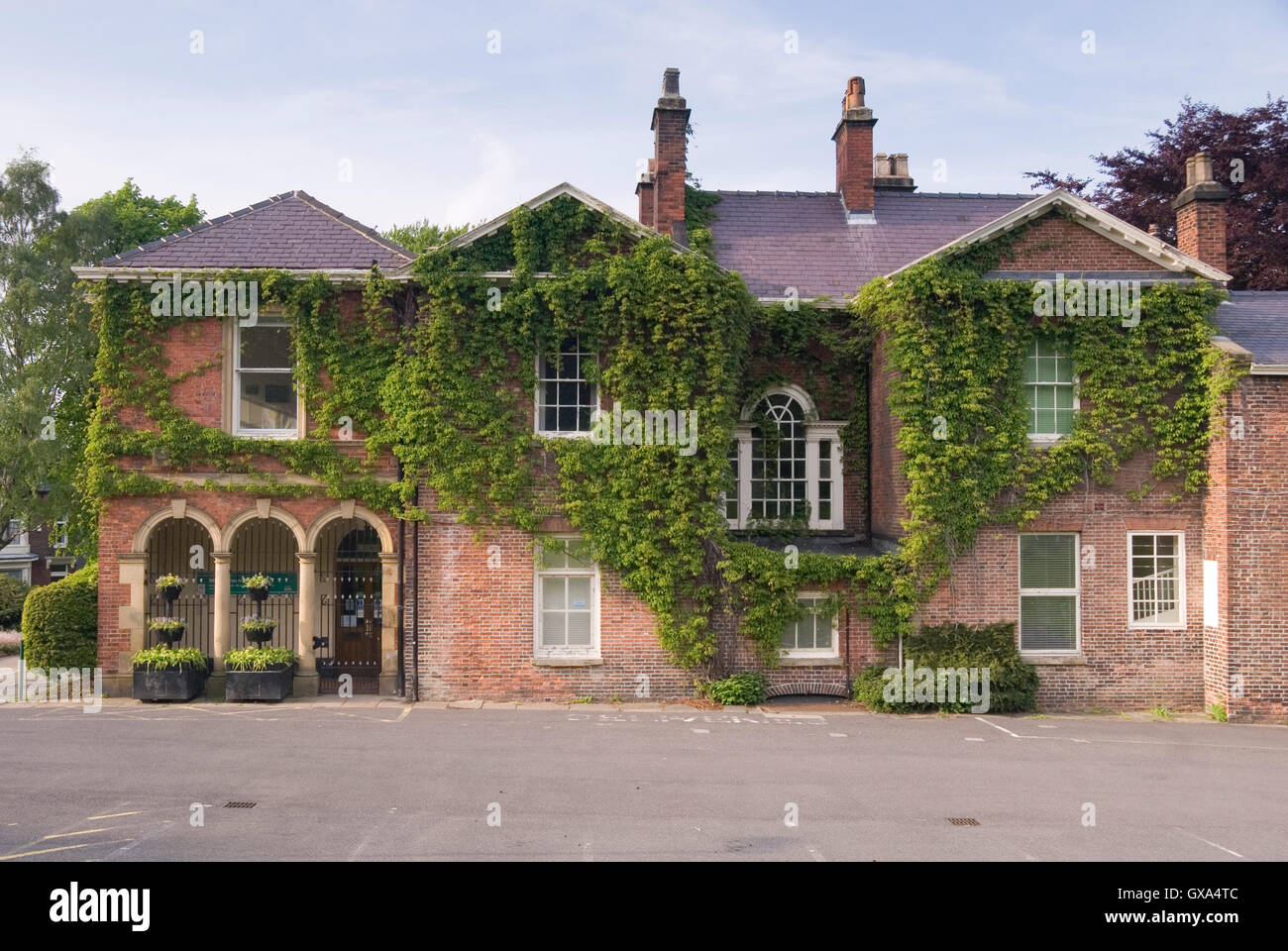 Sheffield, UK - 03 May : Meersbrook House covered in ivy on 03.May 2016 at Meersboork Park, Sheffield. Former home - Stock Image