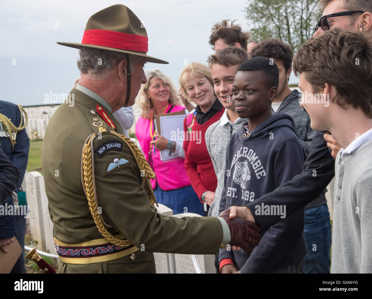 The Prince of Wales meeting schoolchildren as he attends the New Zealand Somme Commemorations at the Caterpillar - Stock Image