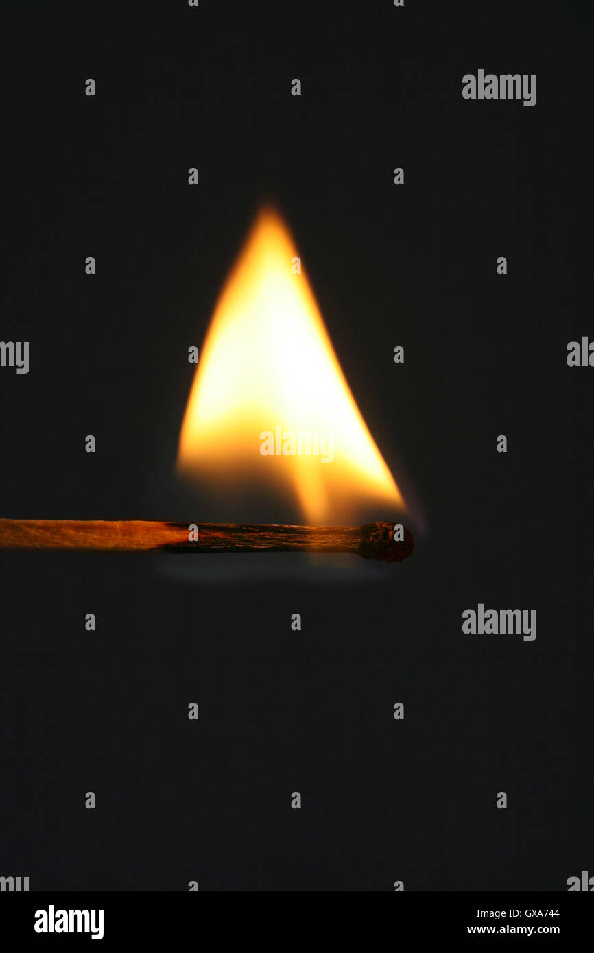 Burning match with bright flame. - Stock Image