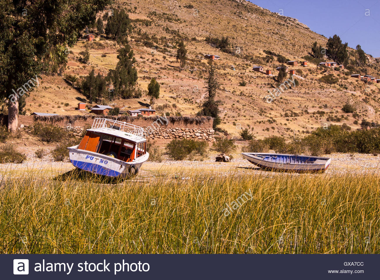 Two aground boats on a shore of Lake Titicaca, Puno, Peru - Stock Image