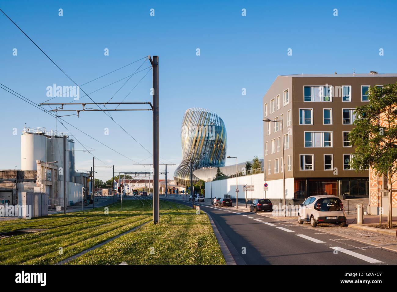 Exterior afternoon shot as seen form the approach showing tram rails and housing. La cité du vin / The City - Stock Image