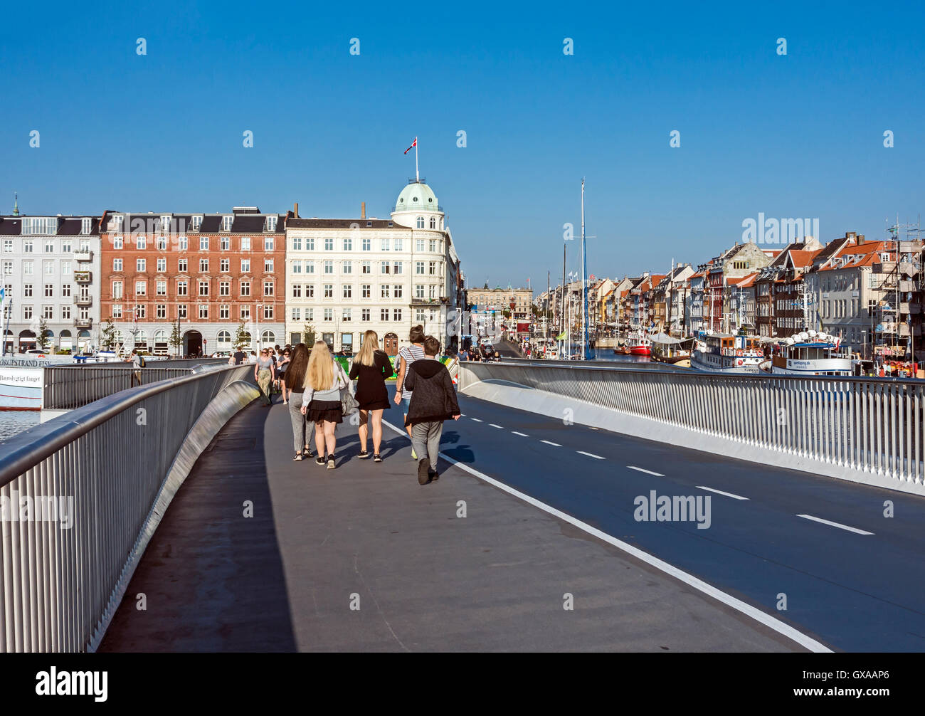 New pedestrian and bicycle bridge Inderhavnsbroen connecting Kongens Nytorv and Christianshavn via Nyhavn in Copenhagen - Stock Image