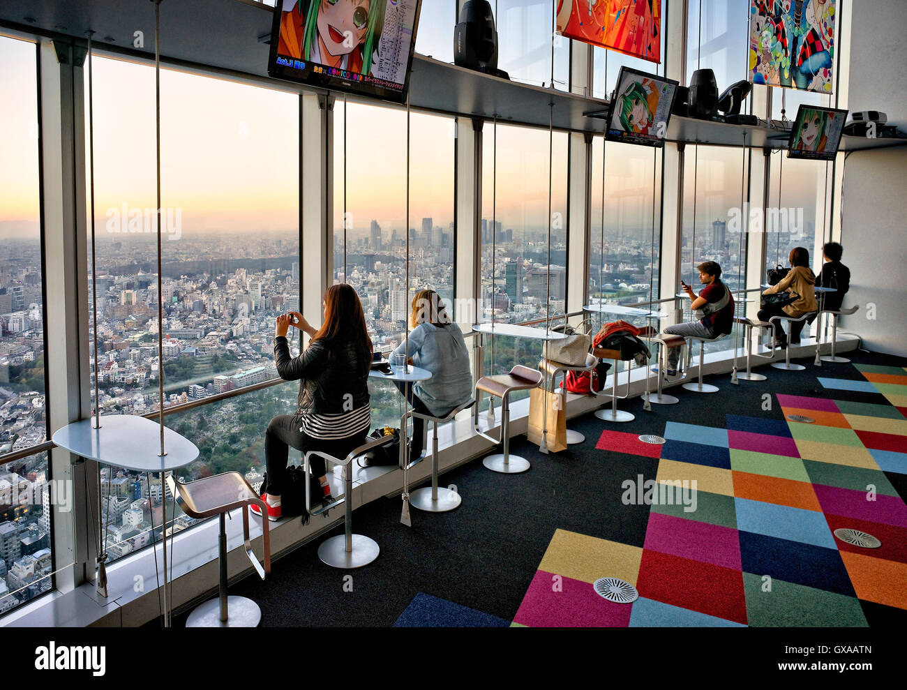 Japan, Honshu island, Kanto, Tokyo, sunset overview from a lounge bar. - Stock Image