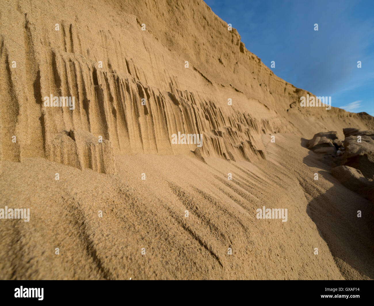 Sand dune sculptured by the wind. - Stock Image