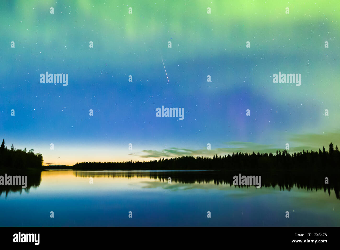 Shooting star and Northern lights on the sky - Stock Image