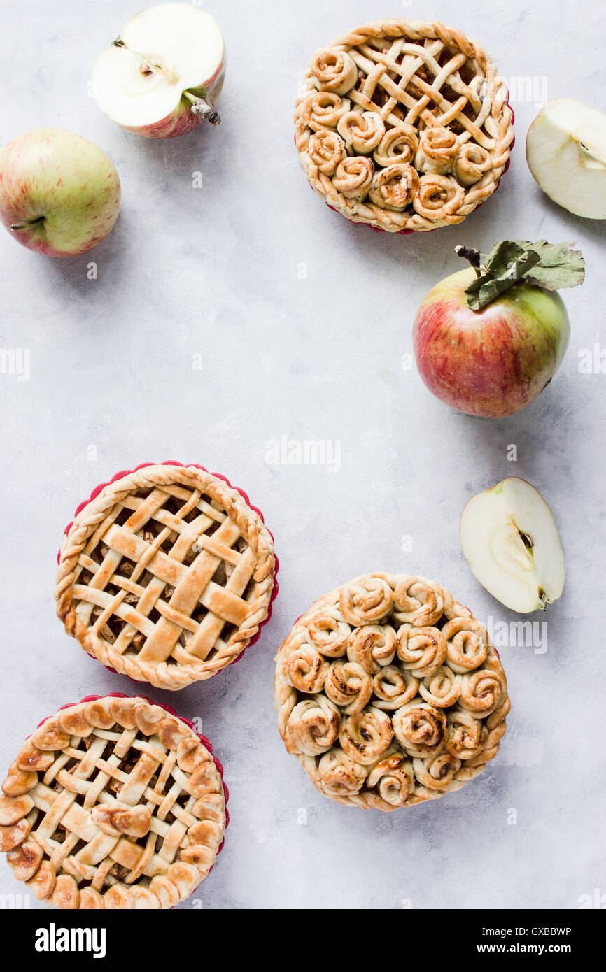 Mini apple pies, decorated with lattice and roses from dough. Top view. Copy paste - Stock Image