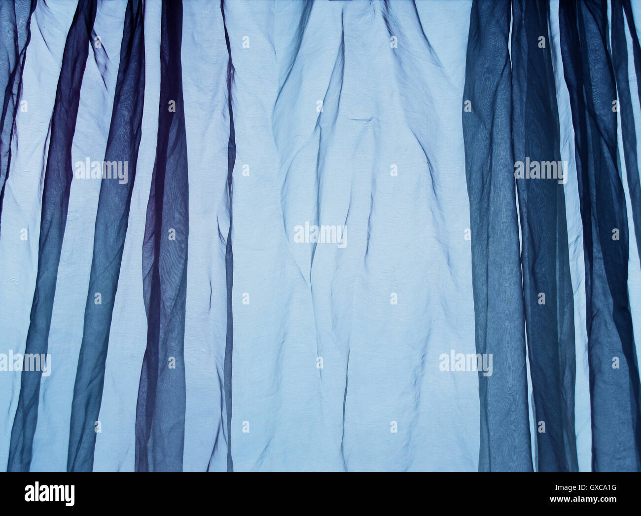 Voile curtain background blue - Stock Image