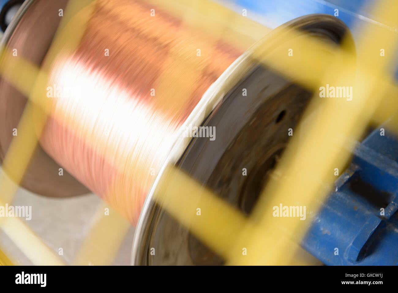 Spinning reel of copper cable in cable factory, close up - Stock Image