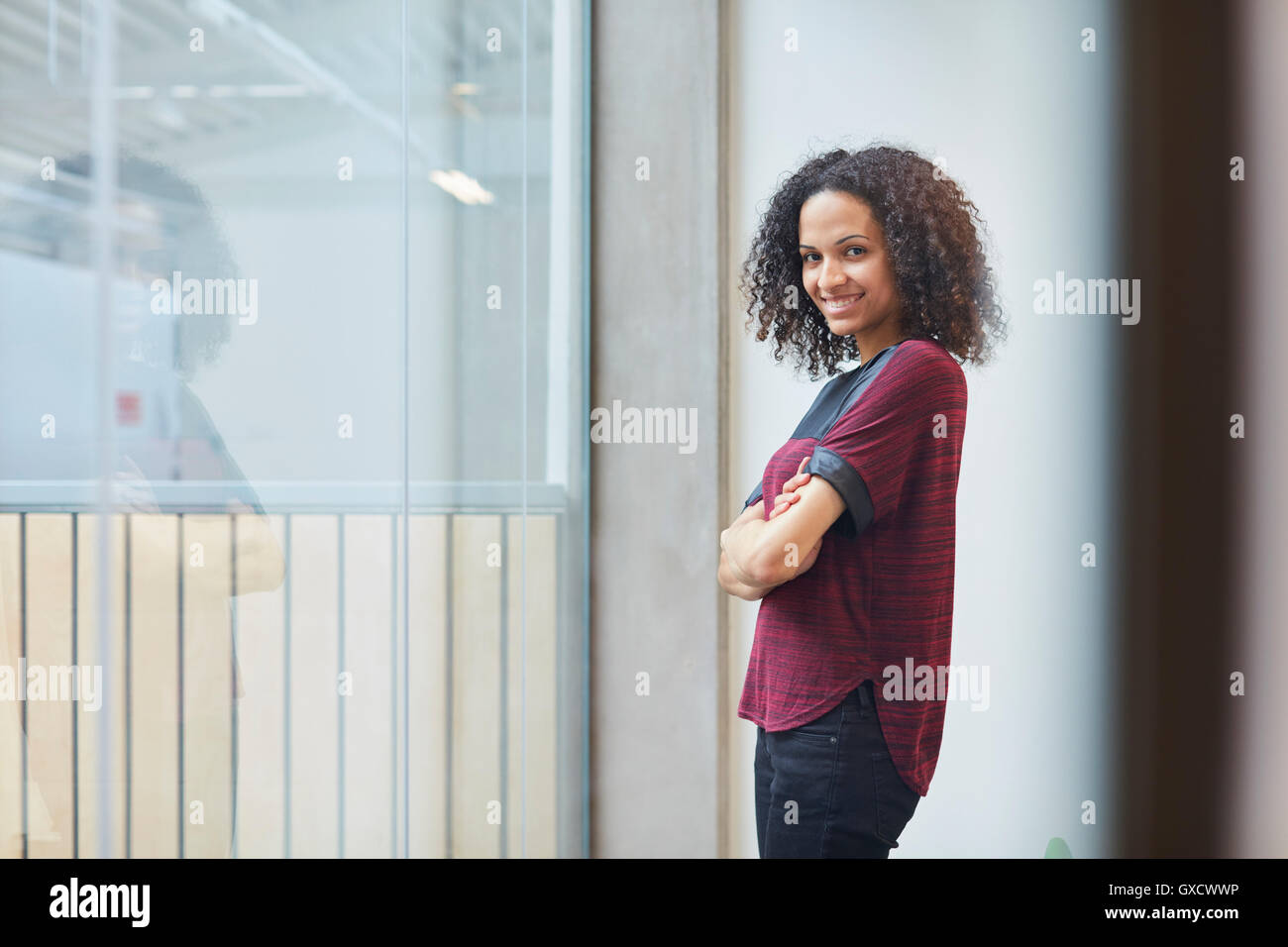 Portrait of young female designer in design studio - Stock Image