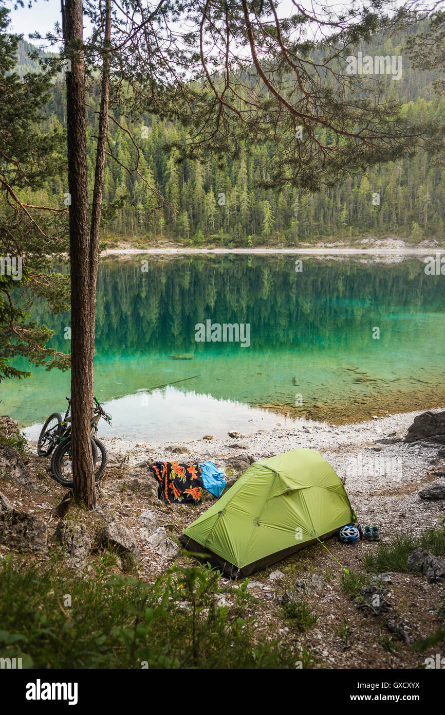 Tent pitched by water, Leermoos, Tyrol, Austria - Stock Image