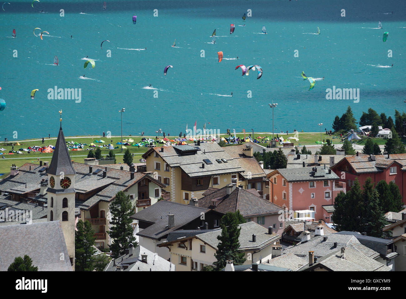 Large group of kitesurfers on turquoise lake by village of Silvaplana near St Moritz, Canton Graubunden, Switzerland - Stock Image