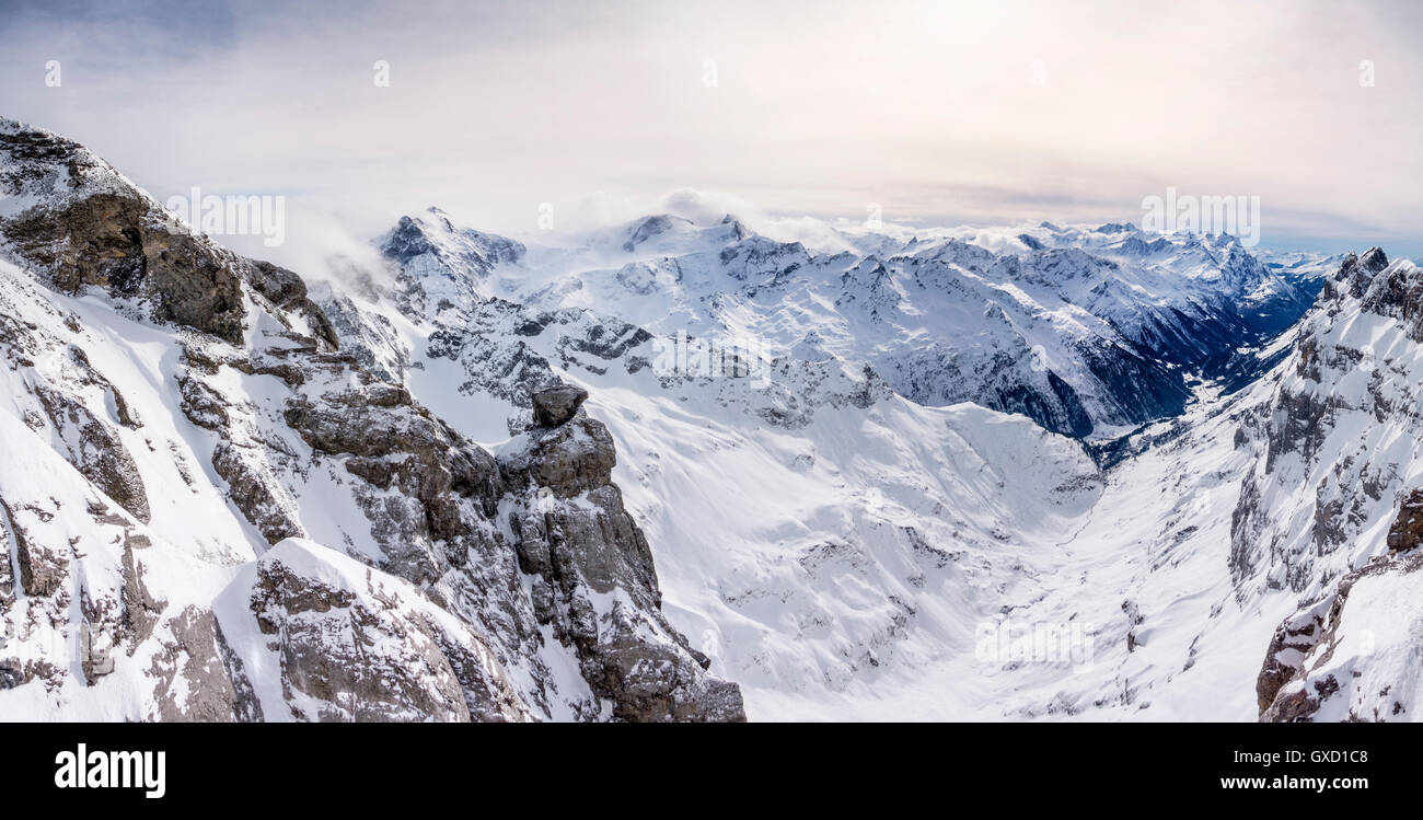 Snow covered landscape and low cloud, Mount Titlis, Switzerland - Stock Image