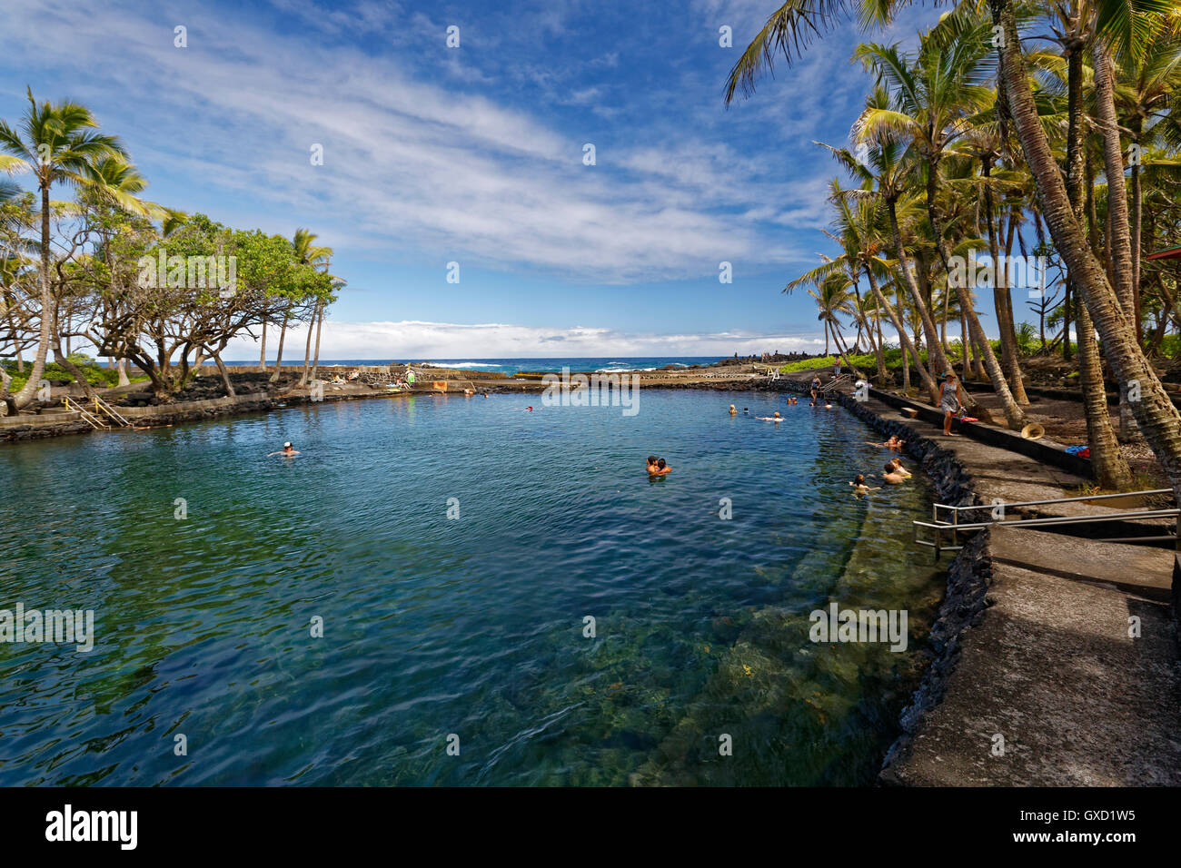 The Alahanui hot springs on the big island of Hawaii, a naturally heated pool that is fed with ocean water - Stock Image