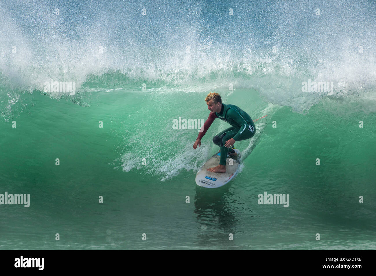 A surfer in spectacular action at Fistral in Newquay, Cornwall. UK. Stock Photo