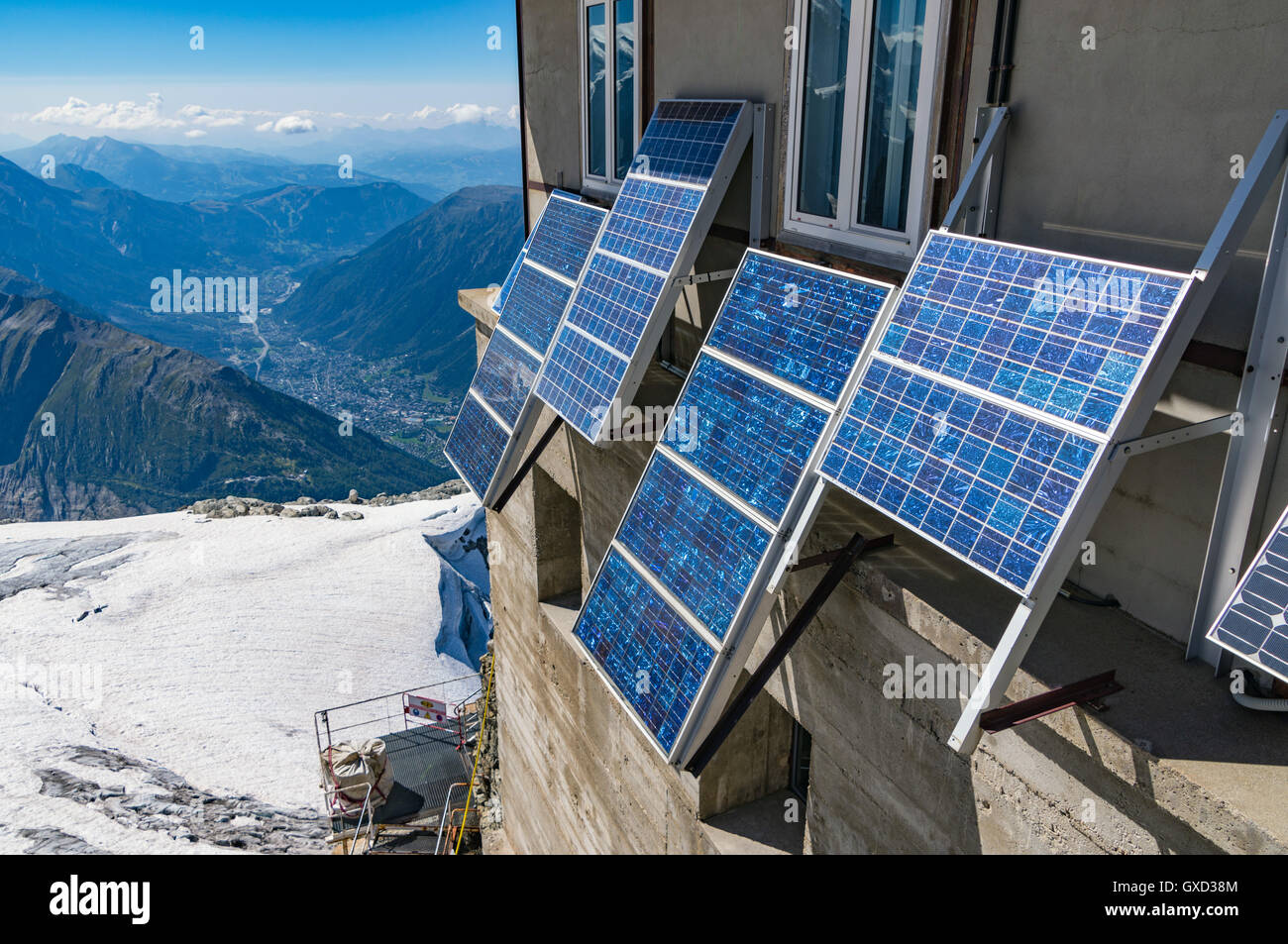Solar panels on side of building, French Alps - Stock Image