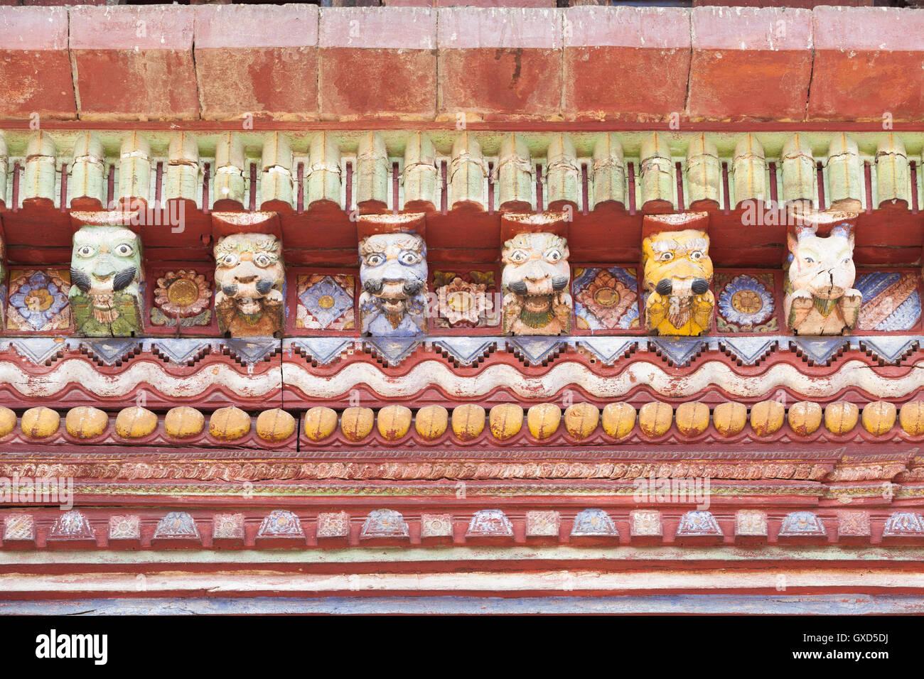 Decorative details in temple roof, hindu deities and demons, Changu Narayan temple near Bhaktapur, Nepal - Stock Image