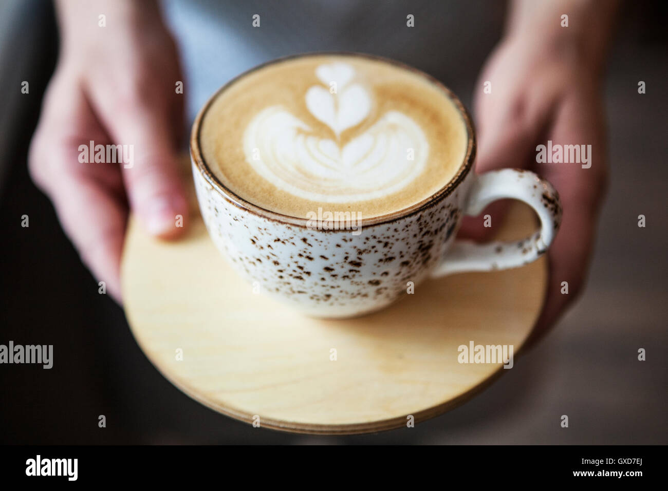Coffee cup. Latte art in cafe. Barista offering coffee - Stock Image