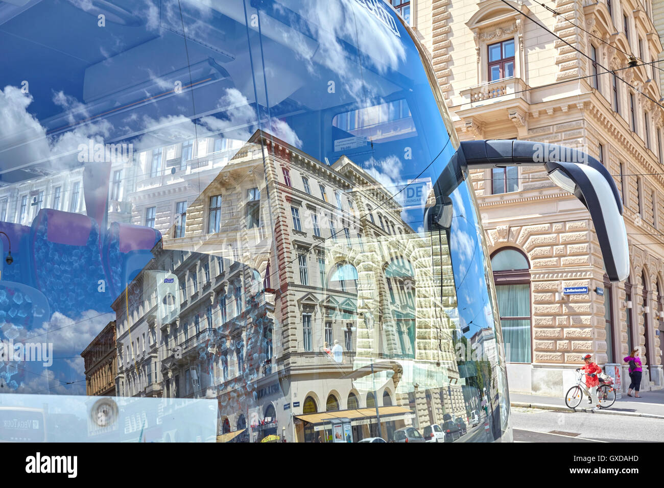 Vienna, Austria - August 14, 2016: Buildings reflection in a tourist bus windshield parked in Vienna downtown. - Stock Image