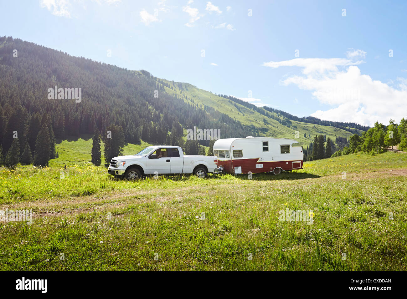 Recreational vehicle and caravan parked in landscape, Crested Butte, Colorado, USA - Stock Image
