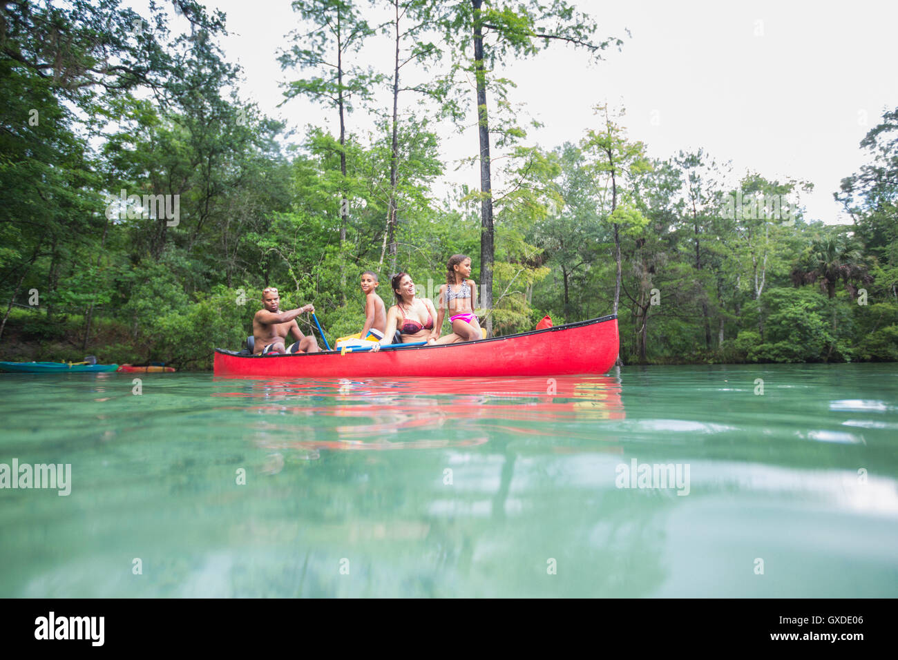 Family on a canoe trip together at Econfina Spring, Florida, USA - Stock Image