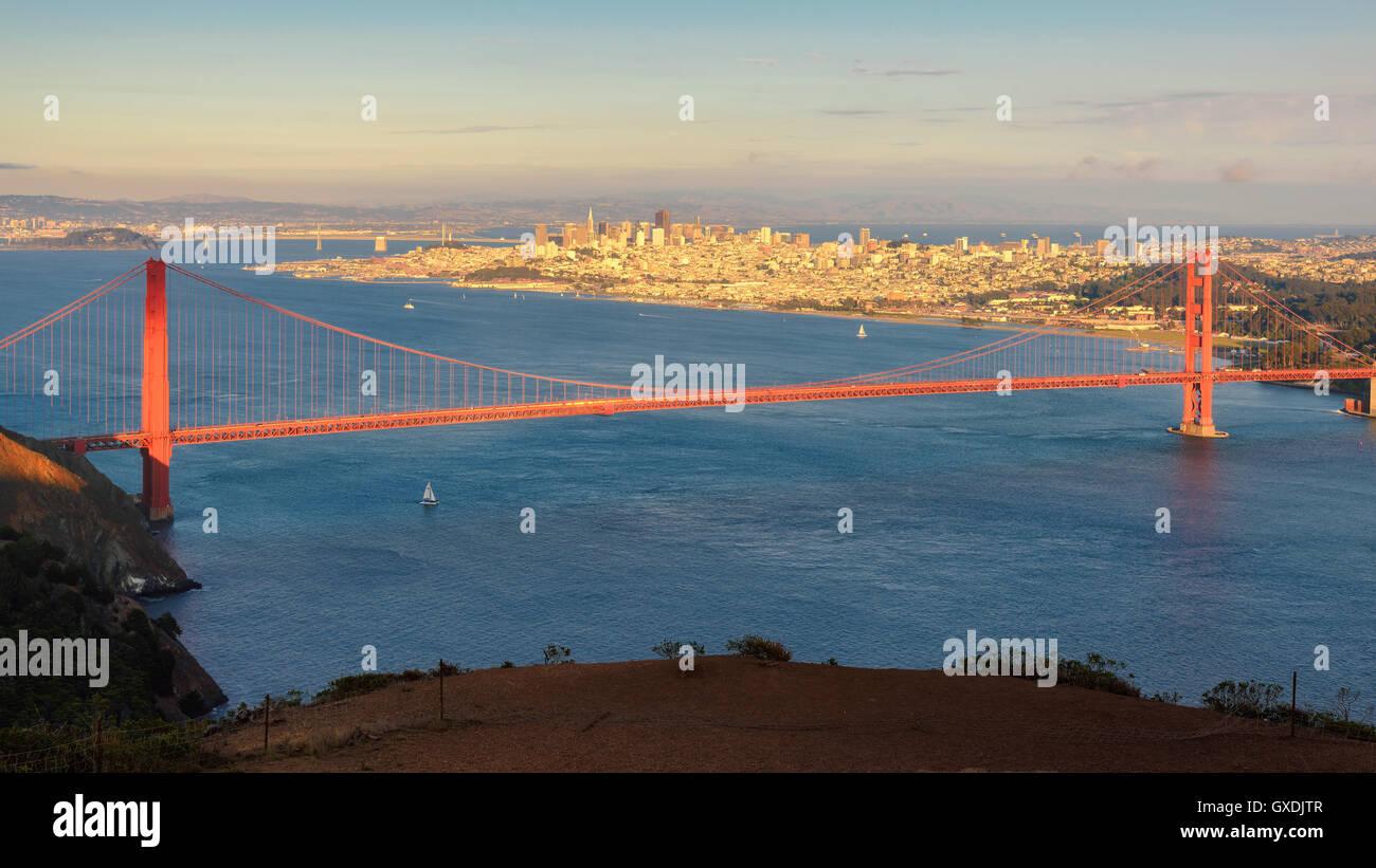 San Francisco Panorama view Golden Gate Bridge from San Francisco Bay at sunset - Stock Image