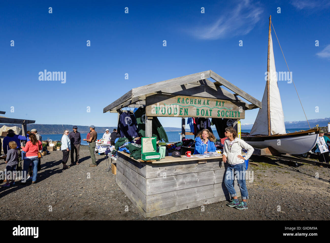 Women Stand By The Kachemak Bay Wooden Boat Society Booth At The
