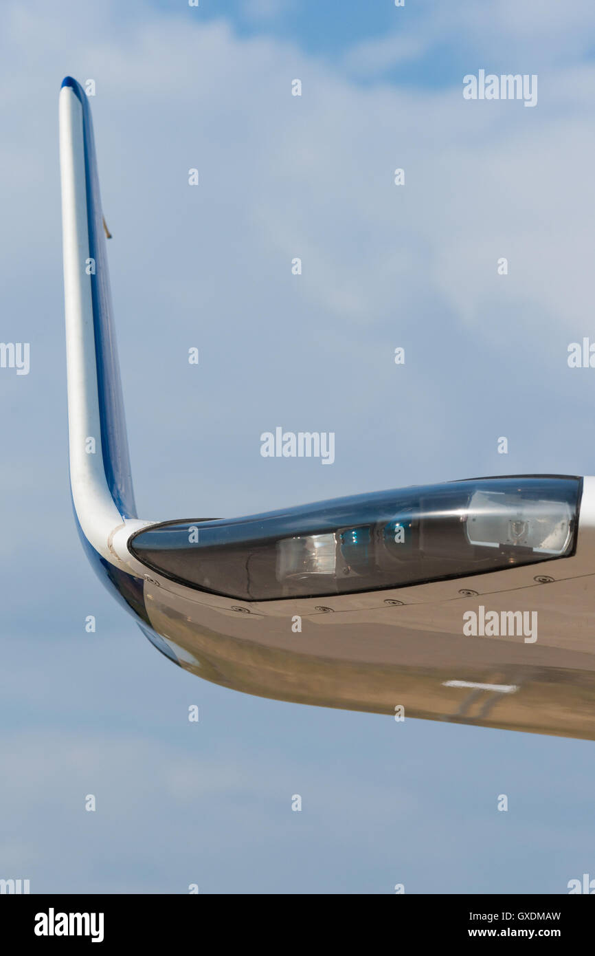 Tip of the wing of a modern civil aircraft and the wing illumination or clearance light against the background of - Stock Image
