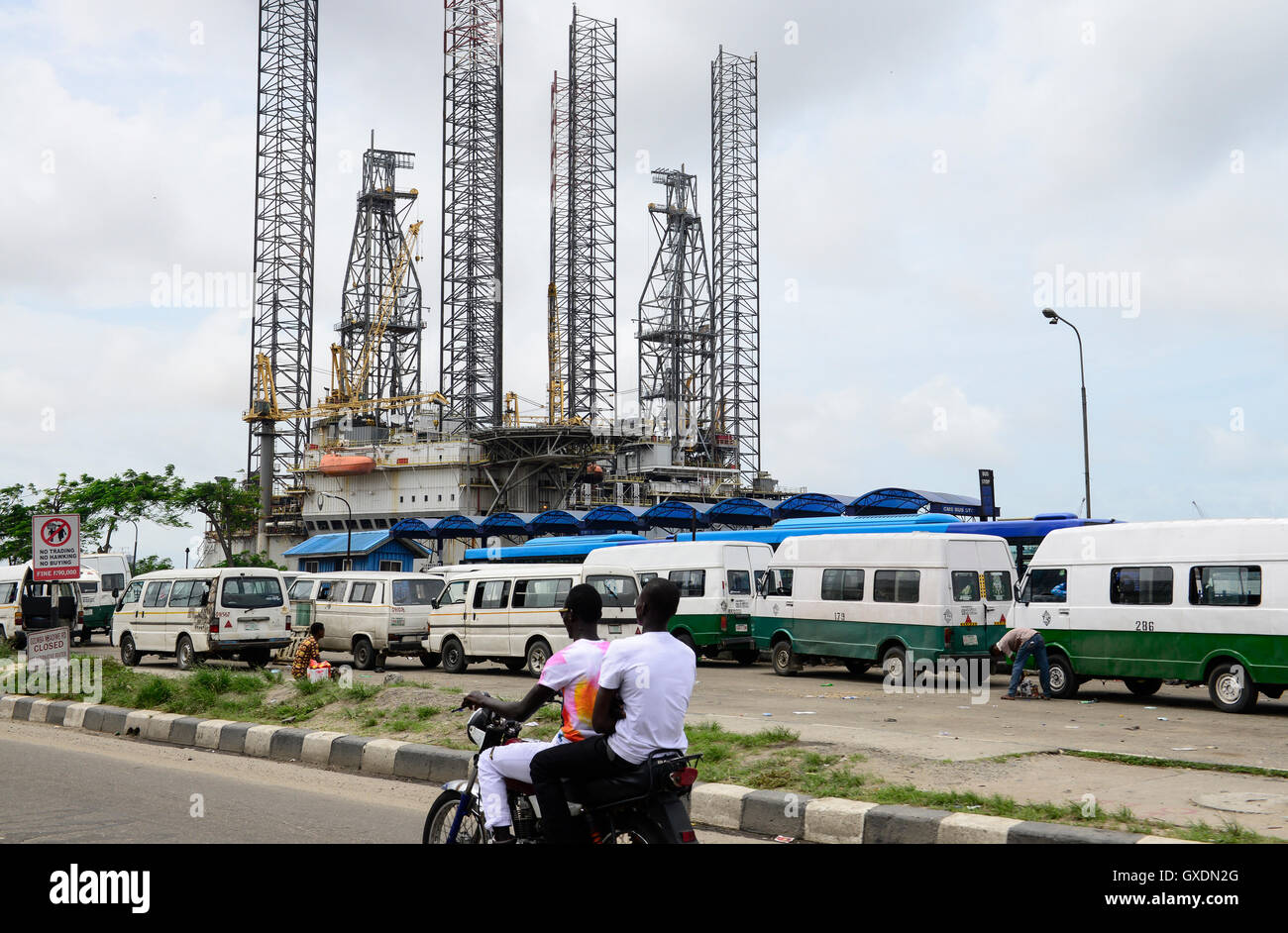 NIGERIA, City Lagos, two oil platform laying in Lagos port, Oritsetimeyin and Onome, traffic and VW Minibus - Stock Image