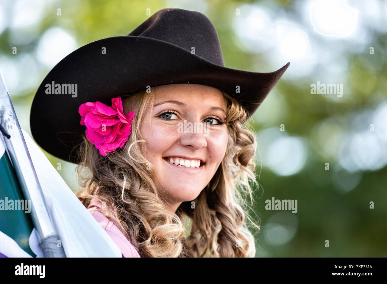 A young woman in cowboy hat smiles during the Cheyenne Frontier Days