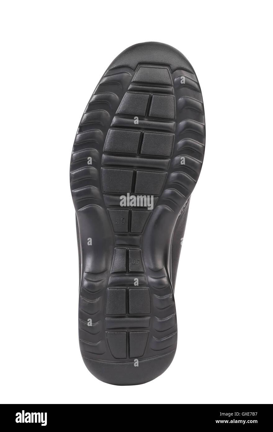 Black shoe soles. - Stock Image
