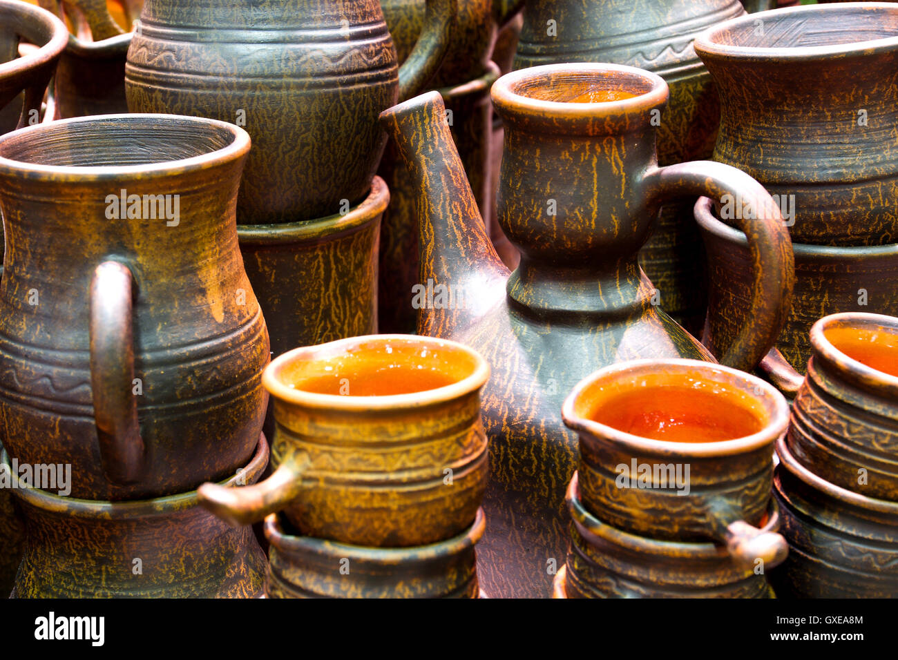 Handmade traditional russian ceramics (crockery things ware jugs pots) on the shopboard at the flea market in Moscow & Handmade traditional russian ceramics (crockery things ware jugs ...